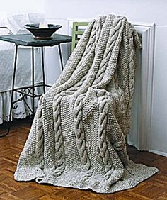 This elegant afghan has a rich look and feel thanks to the textured cable and seed stitch. Both are easy stitches-- even for a novice. (Lion Brand Yarn)