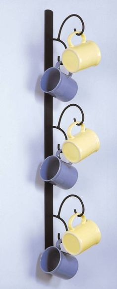 Fine Home Displays - Vertical Mug Tree Simple and sturdy, this six place mug tree is the perfect solution for organizing accessing your favorite coffee, tea, or beer mugs. Rack features a solid black, powder coated surface and is 34 tall. Hooks extend 6 1/2. The perfect way to add a little flair to the breakfast nook or kitchen wall! **MADE IN THE USA!**