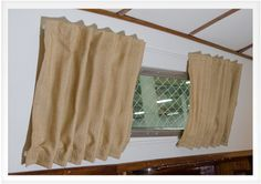Sailrite's excellent directions for boat curtains:  http://sailrite.wordpress.com/2014/01/30/how-to-make-boat-interior-curtains/