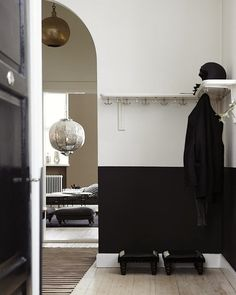 Black Painted Walls, White Walls, Feng Shui, Black Hallway, Entrance Hall Decor, Two Tone Walls, Most Popular Paint Colors, White Wall Bedroom, Hallway Paint