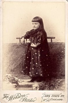 """19th century Cabinet Card of a young girl in a dotted dress, taken at The Wilson Studio in Chicago.  The back of the photograph has the handwritten inscription """"Hody Pody.""""  SOLD"""