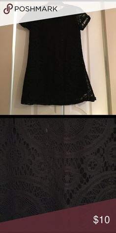 Black tunic Lace black shirt with tunic fit. NWOT, item was a gift! No stains or tears. Size unknown but fits like a small. Note: does not have lining. Tops Blouses