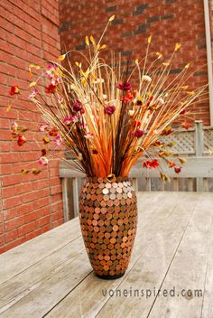Penny-covered vase