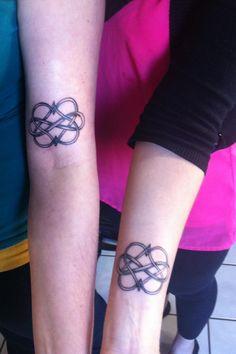 Matching sister tattoos