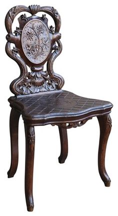 Black Forest carved chair from Breienz with edelweiss details.