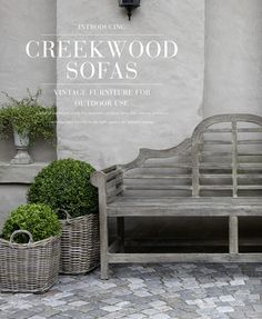 Boxwood and Lutyens Bench~lovely garden benches!