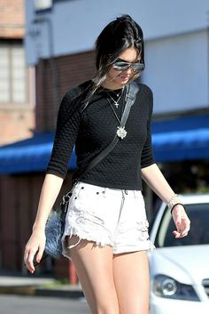 Kendall Jenner / street style : knit top, ripped shorts, Fendi keychain, layered necklaces