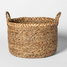 Bring character and texture to your living space with the Large Braided Basket from Threshold™. A natural hue infuses rustic charm into this braided basket that's great for storing extra throw pillows, blankets and other accessories. Better still, it's easy to clean with a dry cloth for lasting use and enjoyment.
