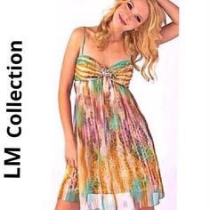 LM COLLECTION special event dress Vibrant colored abstract print chiffon type fabric over a leopard print skirt lining underneath, this dress says WOW! Bandeau style gathered fabric top w/ THEE most beautiful aurora borealis crystals that sparkle & catch the eye making this dress stand out! Baby doll/ empire waist styling, form fitted at breasts then free flowing from there. Molded cups in bodice, wide set straps & back hidden zipper. 100% poly. Great condition. See comment feed for…
