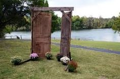 Rustic doorway to make an entrance during an outdoor ceremony | Rustic Wedding Ideas | Blog Post from Vintage Partyware | Vintage and Boho styling and hire for weddings, parties and events in Norfolk, Lincs and Cambs.