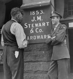 Jimmy Stewart, still in uniform, speaking with his father upon his return from the WWII in Indiana, September 1945