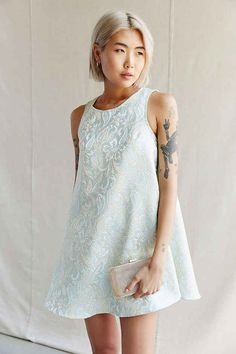 This delicate brocade swing dress.