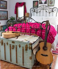 Boho bedroom with antique iron bed and vintage footlocker trunk kellyelko.com