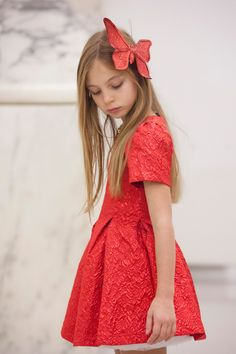 The colours of Christmas: red with Emma and #Paesaggino fall winter 2016 red dress. Photo by @arianacurro #christmas #red #FW16 #fallwinter2016 #children #kids #childrenwear #kidswear #girls