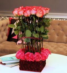 40 Long stemmed and short stemmed roses in a great presentation and fabric boxed vase. $159.99
