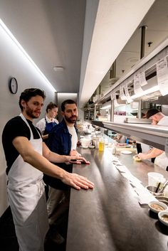 The executive chef, Jake Nemmers, left, and the chef and an owner, Ignacio Mattos, in the kitchen at Flora Bar. (Photo: Daniel Krieger for The New York Times)