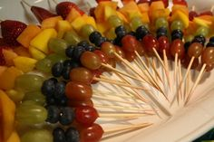 Rainbow fruit kabobs, idea stole from Pinterest! Perfect for the girls circus birthday party.