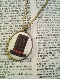 Professor Layton's hat cross stitch necklace by CabbageStitches, $15.00