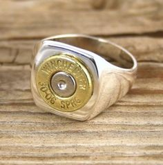 Nothing says 'manly' like our Men's Sterling Silver Bullet Ring! Sure to please! Customize it with your favorite bullet! You can also dress it up with a swar