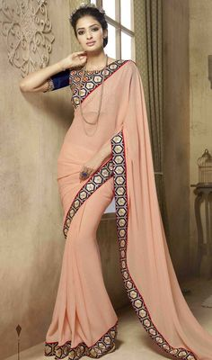 Create an aura of elegance this festive season stepping out in this salmon color shade embroidered silk sari. The ethnic lace and resham work on the saree adds a sign of splendor statement to your look. #pliansilksari #plainborderworksaree #reshamembroideredsarees