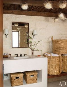 The pool bath, with porcupine fish dangling from the ceiling and round baskets from Mecox.