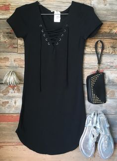The Fun in the Sun Tie Dress in Black is comfy, fitted, and oh so fabulous! A great basic that can be dressed up or down! We love the added detail of the tie front! Sizing: Small: 0-3 Medium: 5-7 Larg