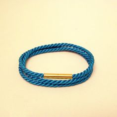 Triple wrap turquoise blue rope bracelet with gold magnetic clasp
