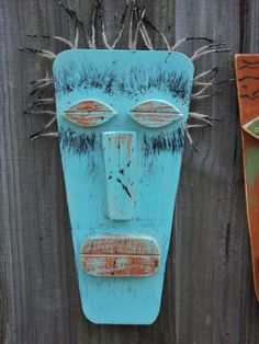 Tiki man, tiki mask, spiritual, tiki bar, African, Hawaiian Primitive style with a weathered look, these colorful tiki masks are made to order and will add some rustic interest (and maybe conversation!) to your decor. **This listing is for the turquoise mask on the left** the others are available in other listings in my shop. Measures 14 3/4 x 7 1/4 (excluding the hair) and is finished with a mix of bermuda bay, crisp autumn leaves and black. I can also make them in custom colors to...