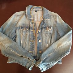 Distressed Cropped Jean Jacket Be casual and trendy in this distressed light colored jean jacket from American Eagle. Has pockets on each side and button cuffs so they can be rolled up over a hoodie or dress. In excellent condition American Eagle Outfitters Jackets & Coats Jean Jackets