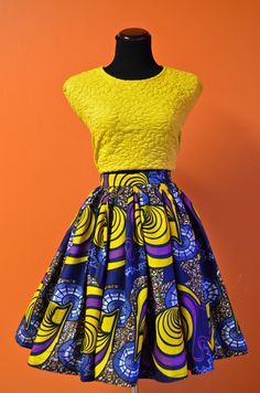 Fitted Imani Skirt  When you walk into the room in this skirt, you'll feel like the life of the party!  This skirt flows nicely from a fitted waistband to a full knee length skirt. Also features a back invisible zipper and yes, it has POCKETS!