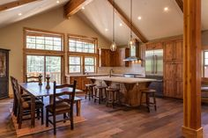 Rustic Kitchen with Kitchen island, Flush, Breakfast bar, Exposed beam, Square Shaker Recessed Panel Knotty Pine, Stone Tile