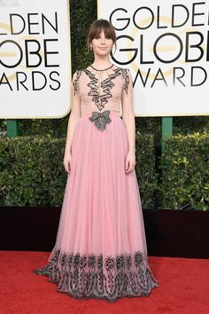Actress Felicity Jones attends the 74th Annual Golden Globe Awards.