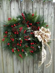 Hang festive holiday wreaths to welcome your guests!