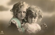 Two little girls. Tinted photograph.