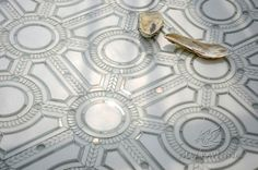 Augustus, a stone and glass waterjet mosaic, shown in honed Thassos, polished Thassos, and Tropical White glass | Designed by Sara Baldwin Designs for New Ravenna