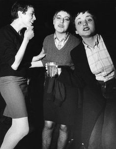 Three skinhead/mod girls, laughing and drinking, UK, 1980's. ©Peter Anderson/PYMCA
