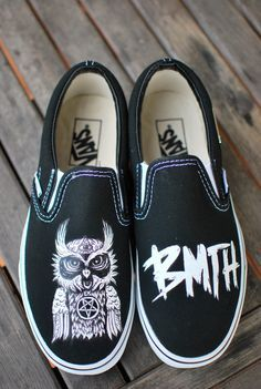 These Black Slip-On Vans feature a hand painted Bring Me The Horizon Owl on the right shoe and the letters BMTH on the left shoe. This order is customizable as I can paint this one-of-a-kind, original
