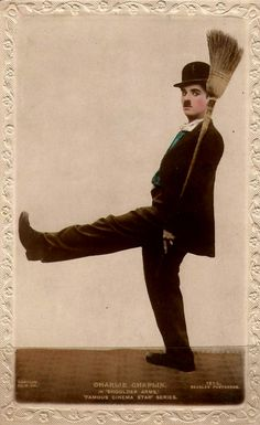 "Cinema card says ""Shoulder Arms"" but he is costumed for ""A Dog's Life"" Charlie Chaplin"
