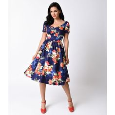 Unique Vintage 1950s Navy & Floral Bouquet Short Sleeve Draper Swing... (£64) ❤ liked on Polyvore featuring dresses, vintage floral dress, navy dress, sweetheart dress, short sleeve floral dress and vintage day dress