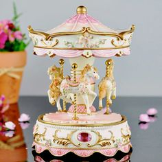 Pink Carousel Gift Music Box - I would LOVE to have this. This is what inspired this whole board to begin with.