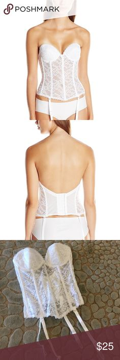 Va Bien Low Back Bustier Features delicate floral lace paneling reinforced with rigid tulle to cinch the waist, with a dramatic low back. Sweetheart neckline and 3-piece cut and sewn cups offer excellent fit and support. Imported Hand Wash Plunging sweetheart neckline Very low back Spiral boning for versatility and comfort Comes with straps and convertible to criss-cross and halter Lovely and sweet in white for bridal, sultry and stunning in black for the boudoir Va Bien  Intimates…