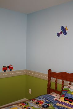 Boy's room painted to match his planes, trains and trucks bedding set.  He loves it!