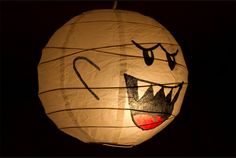 Paper lantern Boo. This would be awesome to a special occasion... or for every day.