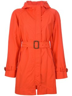 Orange cotton blend 'Iside' coat from Moncler featuring a hood, a concealed front fastening, a buckle fastening belt at the waist, two side patch pockets, a rear vent and long sleeves with buckled strap fastenings.