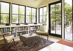 Rosa Beltran Design: THINKING ABOUT LOW BOOKSHELVES -might work in the attic, replace window with slanted ceiling