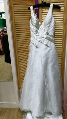 Size 12 Dramatic Wedding Dress from Mind Charity Shop in Harrow.
