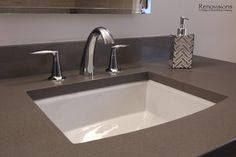 Bathroom remodel by Renovisions. Contemporary style, grey quartz countertop, rectangle undercount sink, chrome fixtures