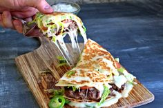 It's a cheeseburger with two jalapeno quesadillas instead of buns. Cut it into quarters and serve it as an appetizer at a party.
