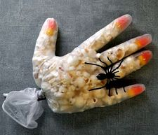 A plastic glove filled with popcorn and candy corn makes a fun project... a very spooky Halloween hand. *pinned by wonderbaby.org