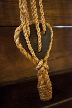 Fiber Rope Tied around a Triangular, Wooden Deadeyes